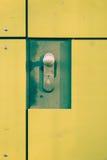 Yellow door with lock. Detail of the yellow door with lock and handle Stock Photos