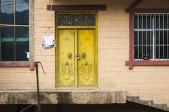 Yellow door of a rural house in Yuanyang stock photography