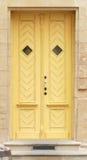 Yellow door. Yellow wooden doors with windows Stock Photography
