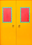 Yellow doors with red frame Stock Photo