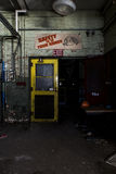 Yellow Doors and Safety Sign in Abandoned Power Plant in New York Stock Photos