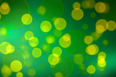Yellow dots on green gradient background. Stock Photos