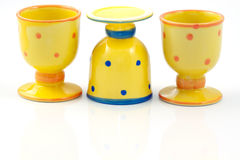 Yellow dotted ceramic egg-cups Stock Photography