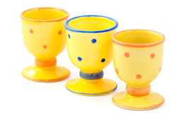 Yellow dotted ceramic egg-cups  Stock Image