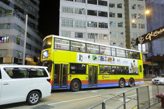 Yellow double decker bus at night Royalty Free Stock Photo