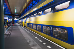 Yellow double-decker train blue Stock Photography