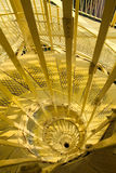 Yellow Downward Spiral. A yellow staircase in a Hungarian tower Royalty Free Stock Image