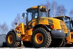 Yellow dozer. New, shiny and modern orange dozer machine. Construction industry machinery royalty free stock photo