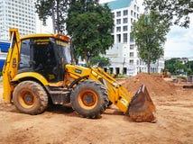 Yellow dozer. Khon Kaen, THAILAND - July 7, 2018: Yellow dozer parked on the construction site royalty free stock photos