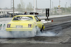Yellow drag car smoke show Royalty Free Stock Images