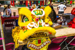 Yellow dragon head costume Seattle Chinatown festival. Yellow dragon head costume used for traditional dragon dance Stock Photo