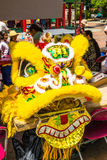 Yellow dragon head costume  Seattle Chinatown festival Stock Photos