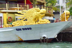 Yellow dragon head on prow of boat Royalty Free Stock Photo