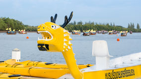 Yellow Dragon Head on a Race Boat. Stock Photo