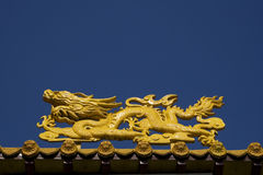 Yellow Dragon at Temple. A close up of a temple dragon. This is in the Chinese style and has much symbolism to the Chinese stock photos