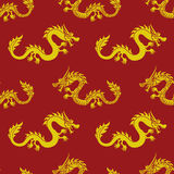 Yellow dragons on a red background Royalty Free Stock Image
