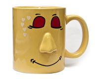 Yellow dreamy love cup. Dreamy smiling coffee cup with nose and closed eyes Royalty Free Stock Images