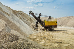 Yellow dredge in sandy to career Royalty Free Stock Photography