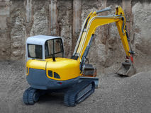 Yellow Dredger. On a construction site Stock Images