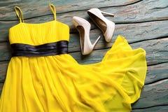 Yellow dress and beige heels. Stock Photos