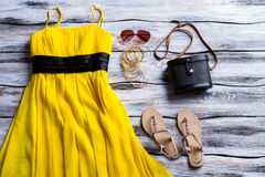 Yellow dress and beige sandals. Stock Photography