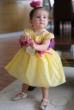 Yellow dress girl. Yellow dress little girl standing royalty free stock photo