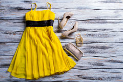 Yellow dress, purse and shoes. Royalty Free Stock Photos