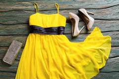 Yellow dress and silver purse. Royalty Free Stock Photo