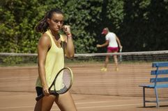 Yellow dress tennis woman decided face won point. Tight fist. International tennis tournament for women. The tournament took place in Romania Stock Photos