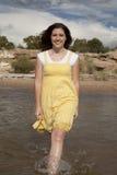 Yellow dress water Stock Photography