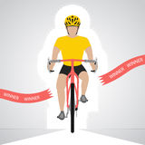 Yellow dressed cyclist in front view crossing red finish line   Stock Photography