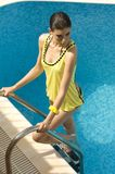 Yellow dressed woman coming out the swimming pool  Stock Image