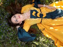 Yellow Dressed Woman on Green Leafed Plant Royalty Free Stock Image