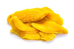 Yellow dried mango strips isolated on white background stock photography