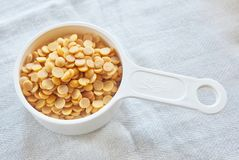 Yellow Dried Soybeans in A Measuring Spoon. Cuisine and Food, Dried Soybeans or Edamame Seeds in A Measuring Spoon royalty free stock photos
