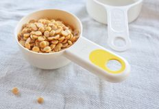 Yellow Dried Soybeans in A Measuring Spoon. Cuisine and Food, Dried Soybeans or Edamame Seeds in A Measuring Spoon stock images