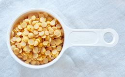 Yellow Dried Soybeans in A Measuring Spoon. Cuisine and Food, Top View of Dried Soybeans or Edamame Seeds in A Measuring Spoon stock photos