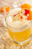 Yellow drink with almonds Stock Image