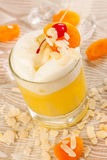 Yellow drink with almonds and apricots Royalty Free Stock Photo