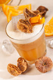 Yellow drink with figs Stock Photography