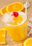Yellow drink with lemon and orange Royalty Free Stock Photography