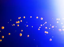 Yellow drops on blue Royalty Free Stock Photo