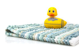 A yellow duck and bathmat Stock Images