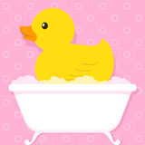 Yellow duck in bathtub with bubbles Stock Photo