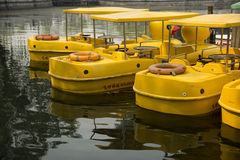 Yellow duck boat. There are several yellow duck shaped boat on the water Royalty Free Stock Image