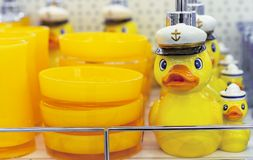 Yellow duck in a marine cap dispenser for liquid soap stock images