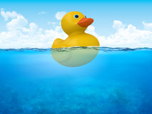 Yellow duck in open sea Royalty Free Stock Photography