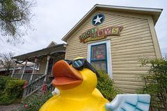 Yellow duck statue in front of store in Gruene Texas Stock Images