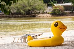 Yellow Duck swim tube on the beach Inflatable duck.Fantasy Swim. Ring for Summer sea Trip on the beach at the Koh Samet island, Rayong, Thailand Stock Photo