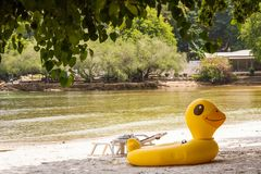 Yellow Duck swim tube on the beach Inflatable duck.Fantasy Swim. Ring for Summer sea Trip on the beach at the Koh Samet island, Rayong, Thailand Stock Image